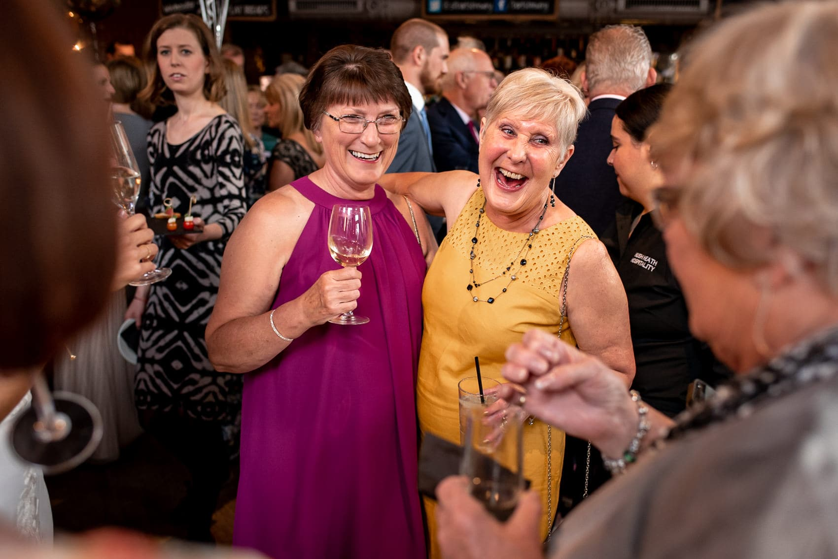Wedding guests laughing and hugging at a St Barts Brewery wedding in London