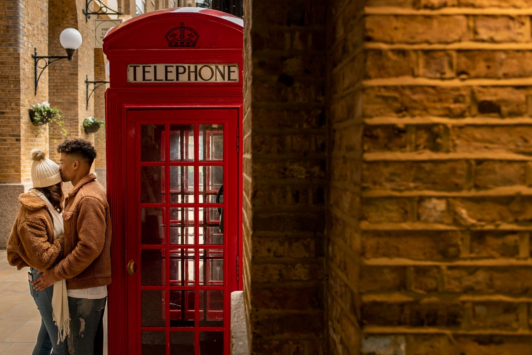 Couple kissing next to a London Red telephone box
