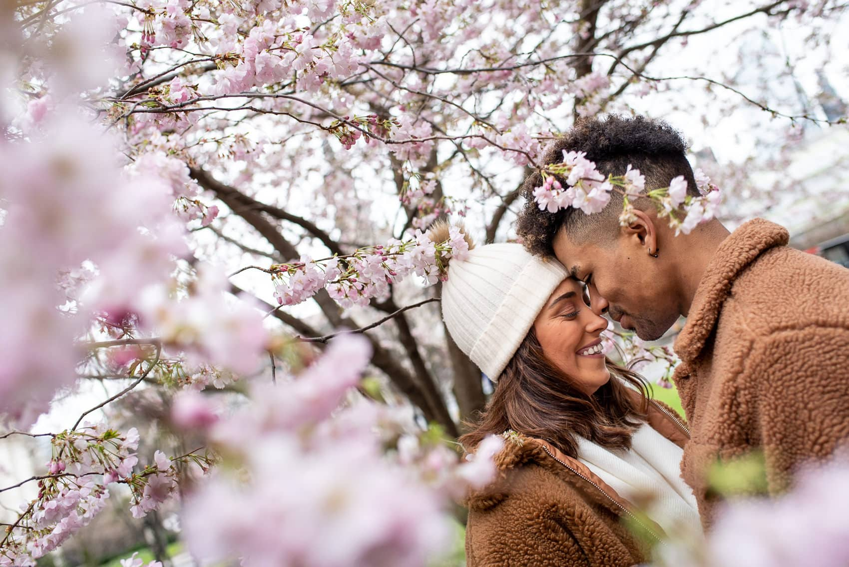 Photo of couple on their Cherry Blossom engagement shoot in London in March
