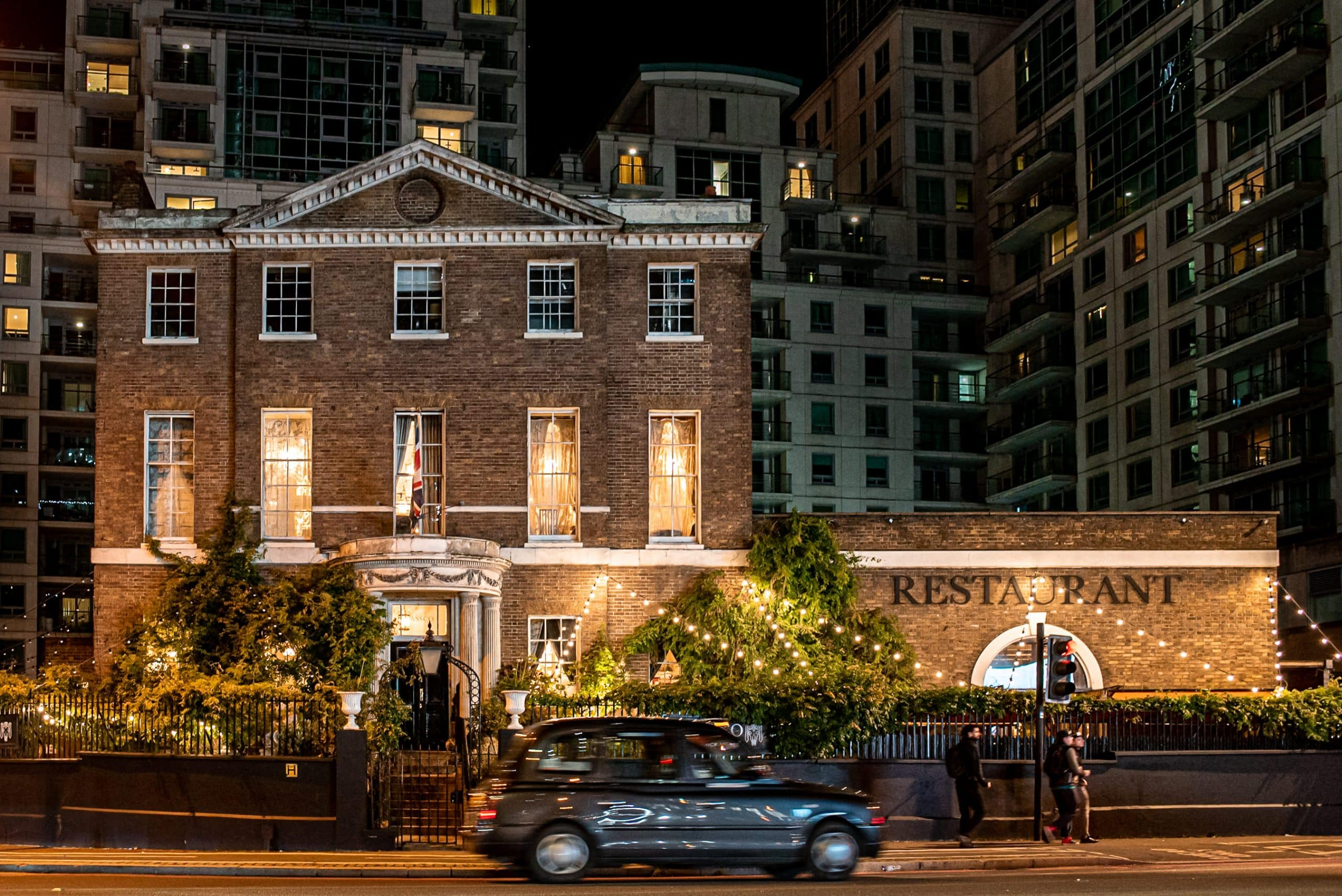 A photo of the outside of Lassco Brunswick House Wedding venue in London at night