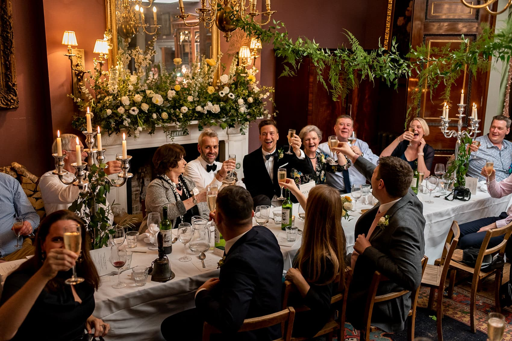 guests raising their glasses to toast during a Brunswick House wedding