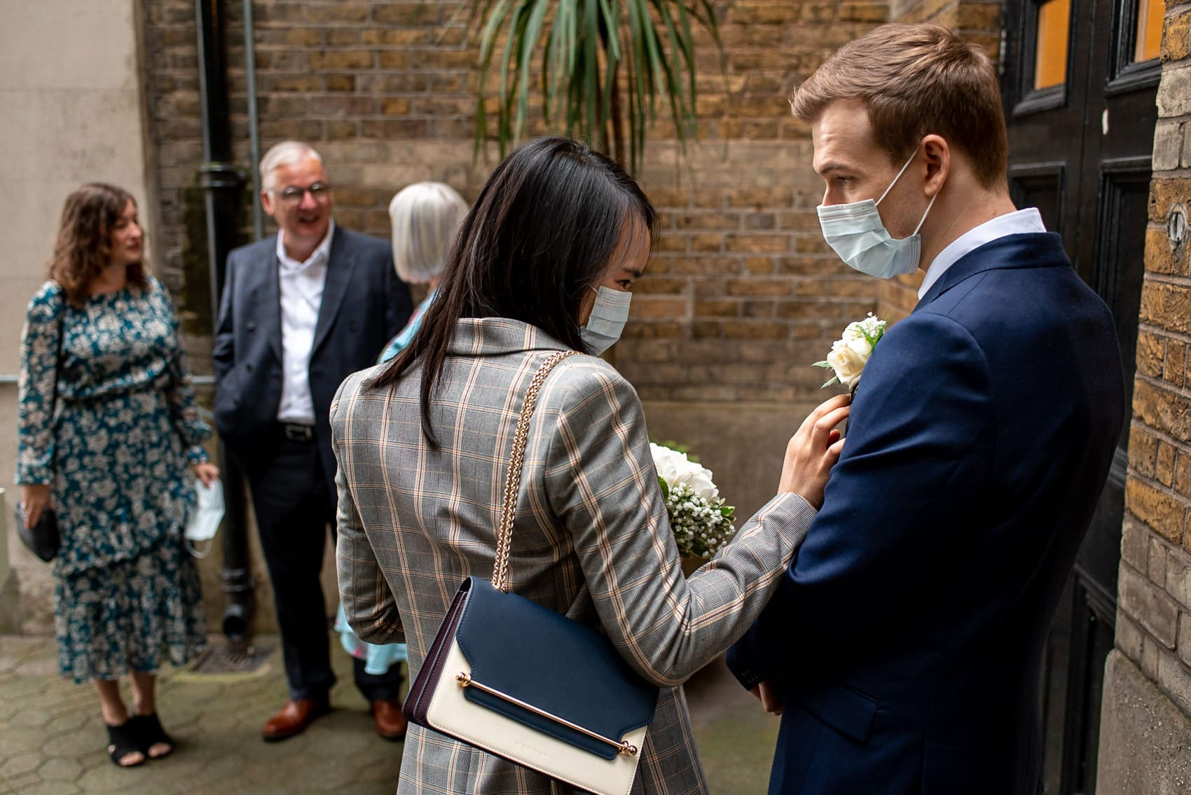 Photo of couple wearing masking during their covid london wedding in 2020
