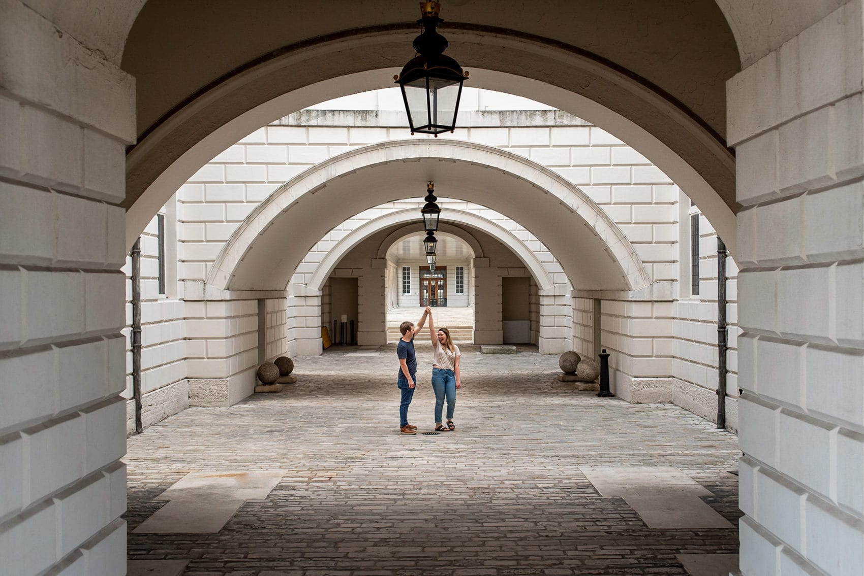 Couple dancing inside the Maritime museum during their Greenwich wedding proposal shoot