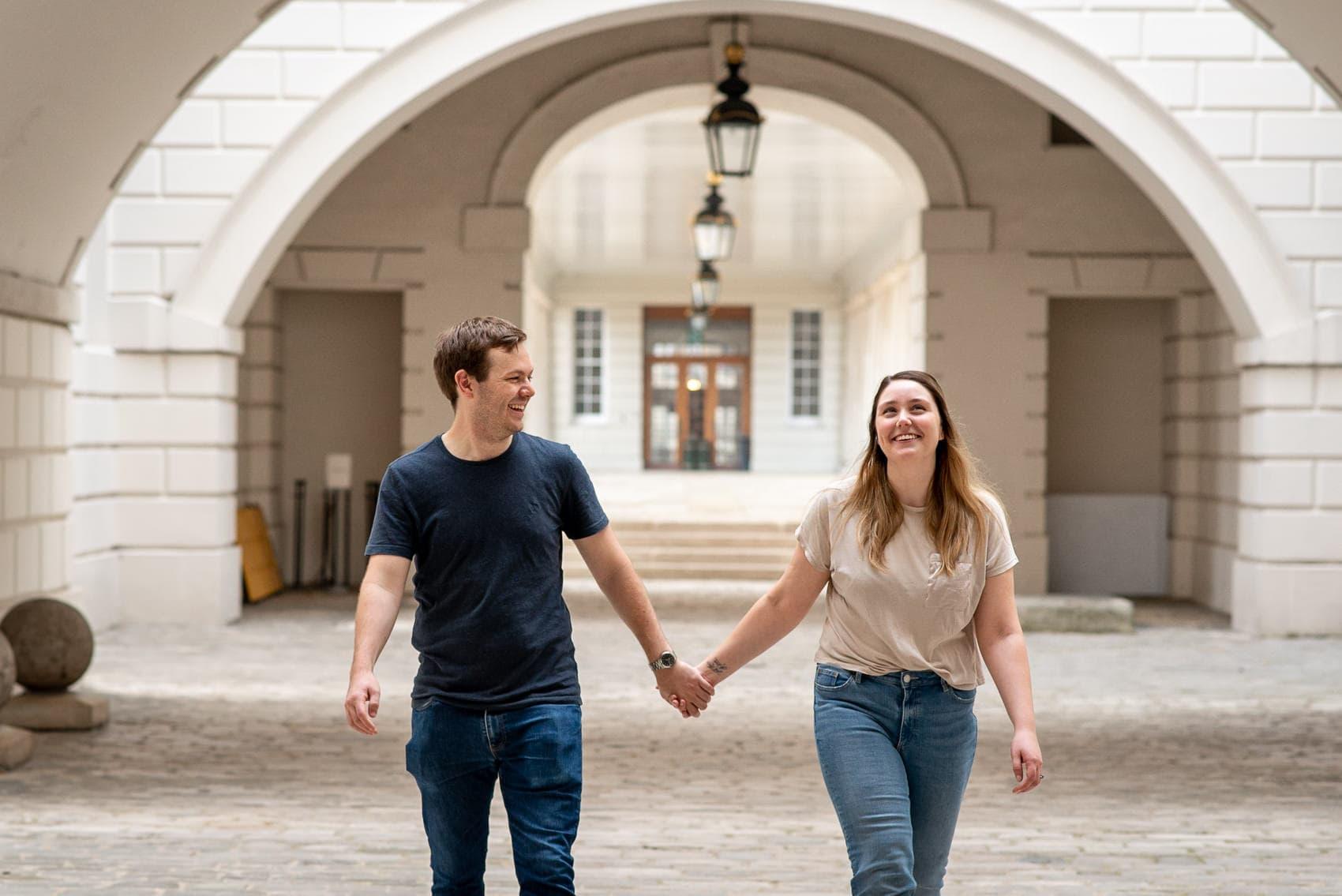 Couple walking inside the maritime Museum in Greenwich, London