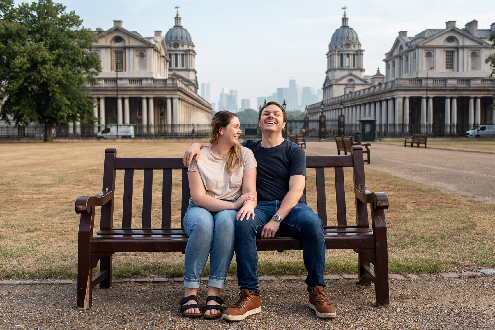 Greenwich Proposal Photos of Couple sitting on a bench and laughing