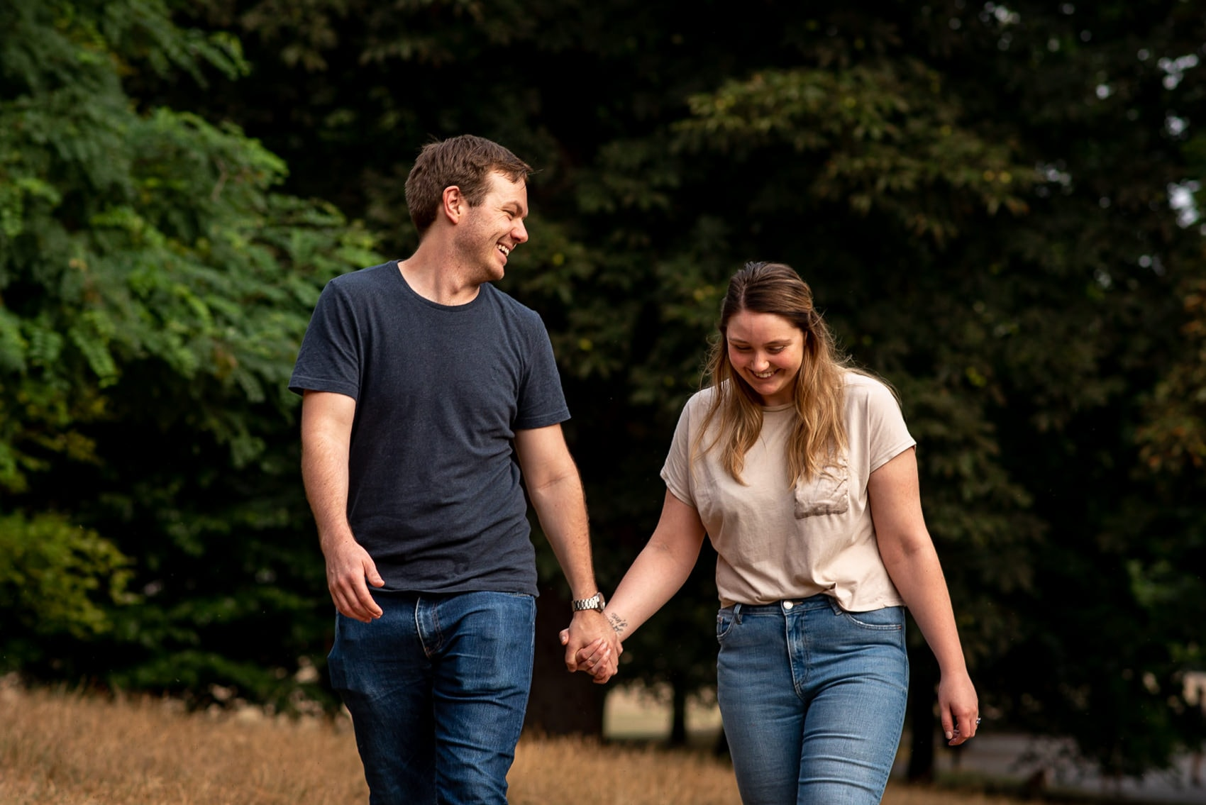 couple laughing on their greenwich park engagement shoot