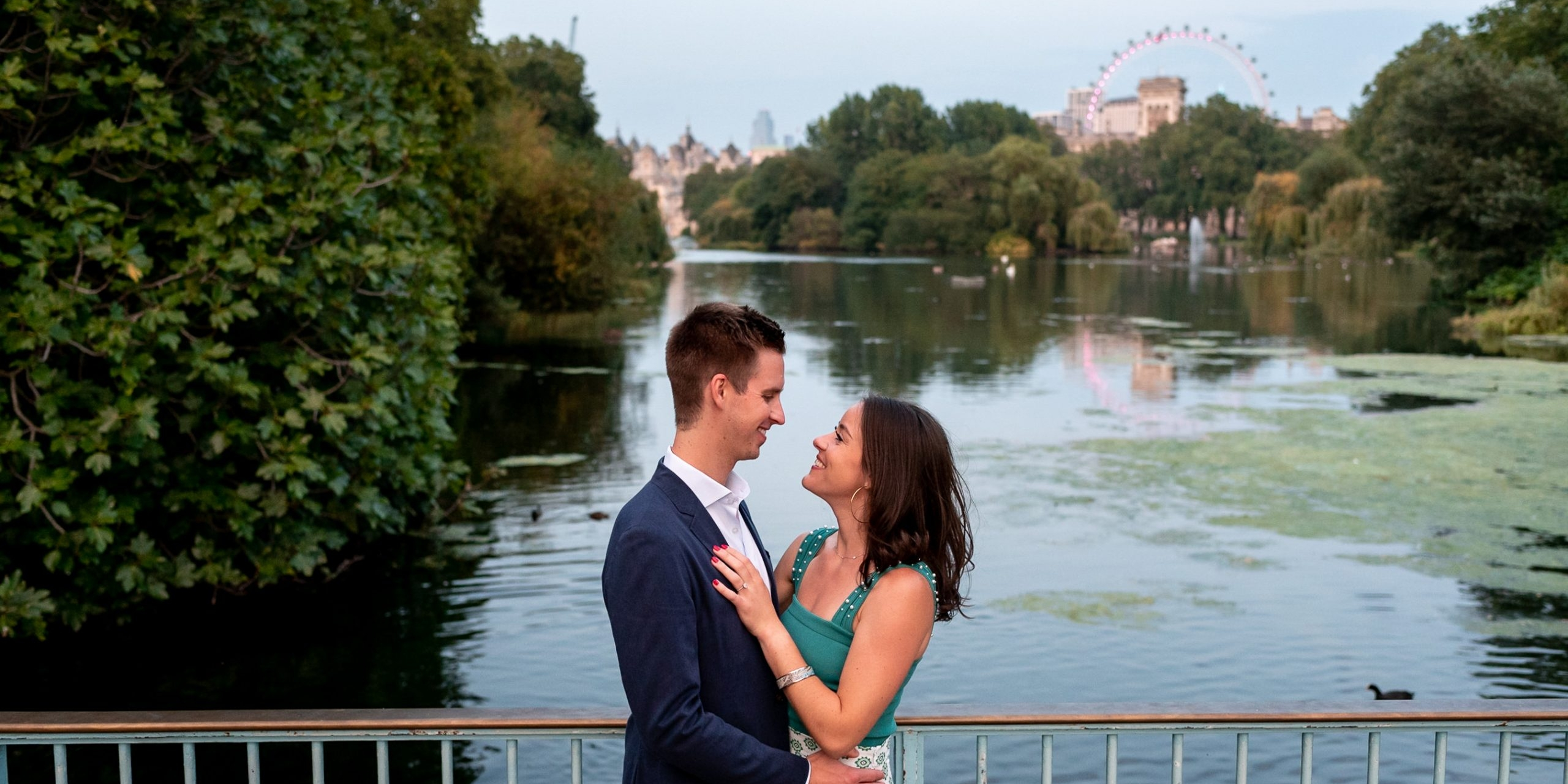 photo of couple on their St James Park Engagement Shoot over looking the lake and the London Eye taken by photographer Matt Badenoch