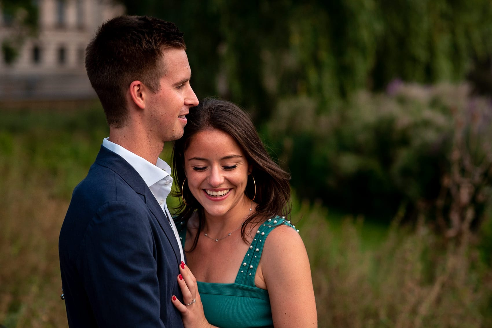 couple laughing during their St James Park engagement photo shoot