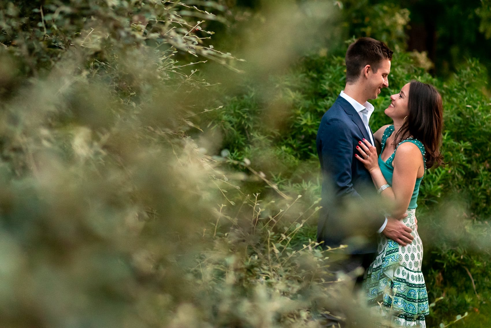 Couple surrounded by trees during their St James Park engagement photography session in London