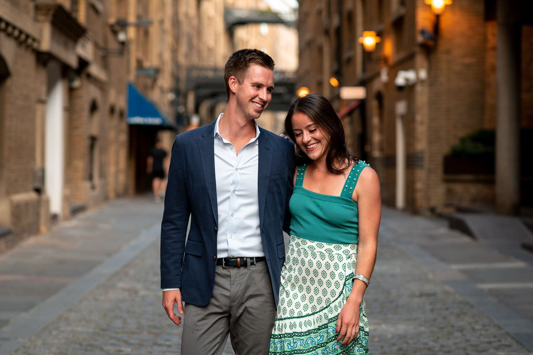 couple walking along the Shad Thames during their London engagement shoot