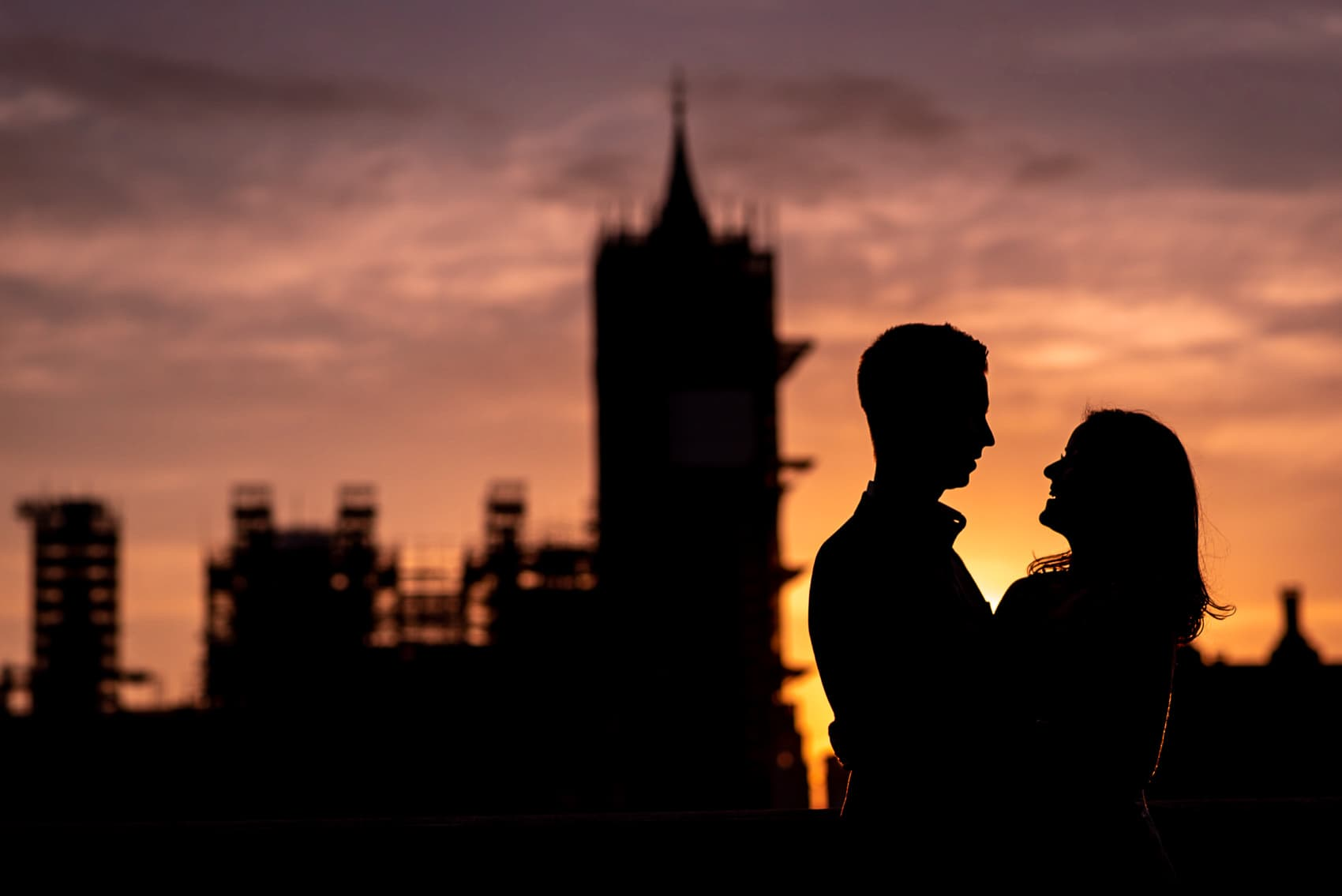 Sunset photo of couple in front of Big Ben on their London Engagement photo shoot