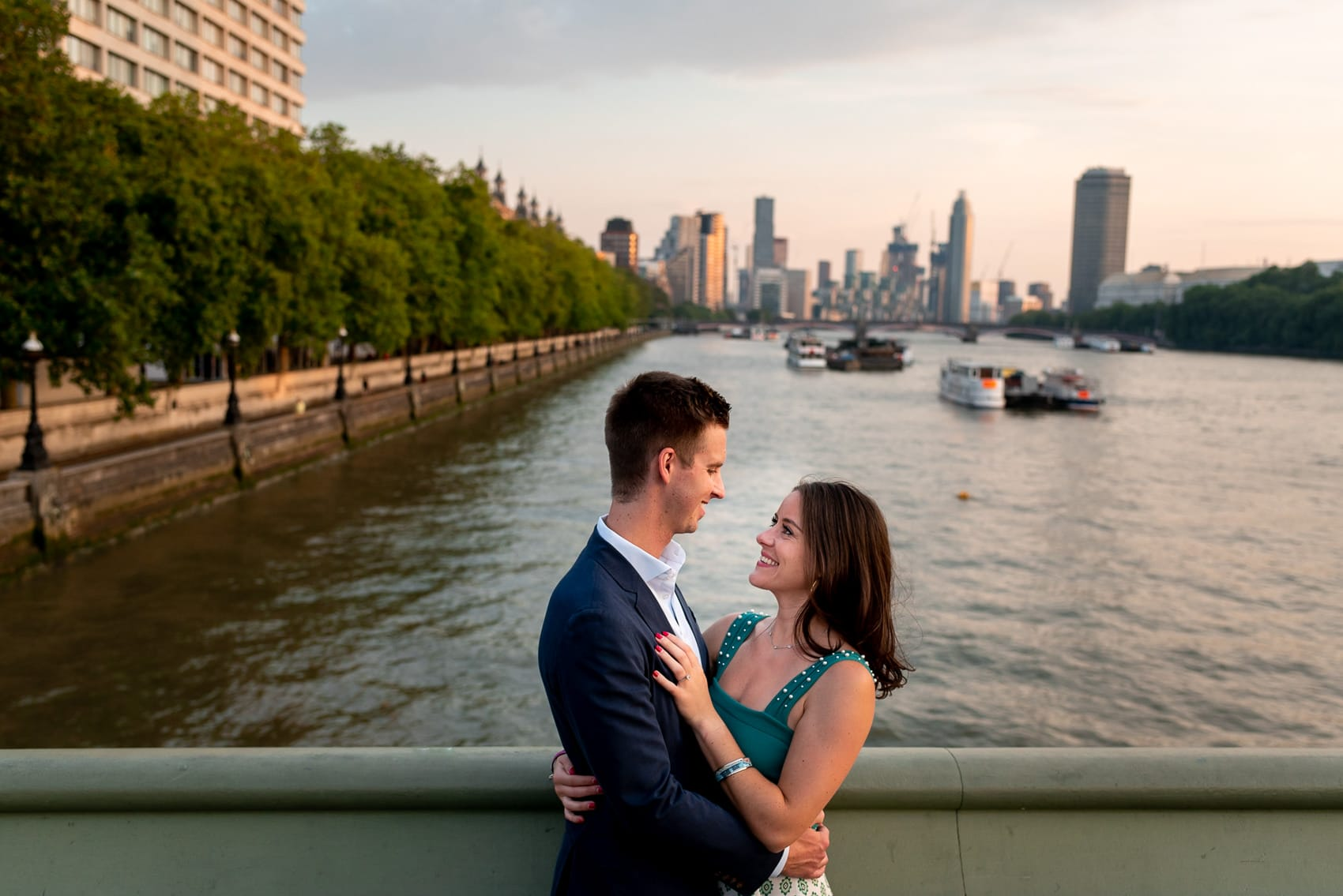 couple over looking The Thames at sunset during their London engagement photography session