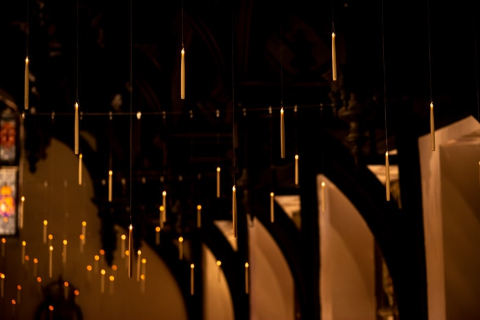 Candles floating on the ceiling of Middle Temple for a Harry Potter themed Christmas wedding
