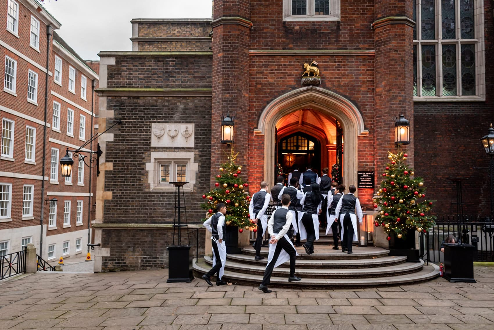 waiters entering Middle Temple at Christmas in London