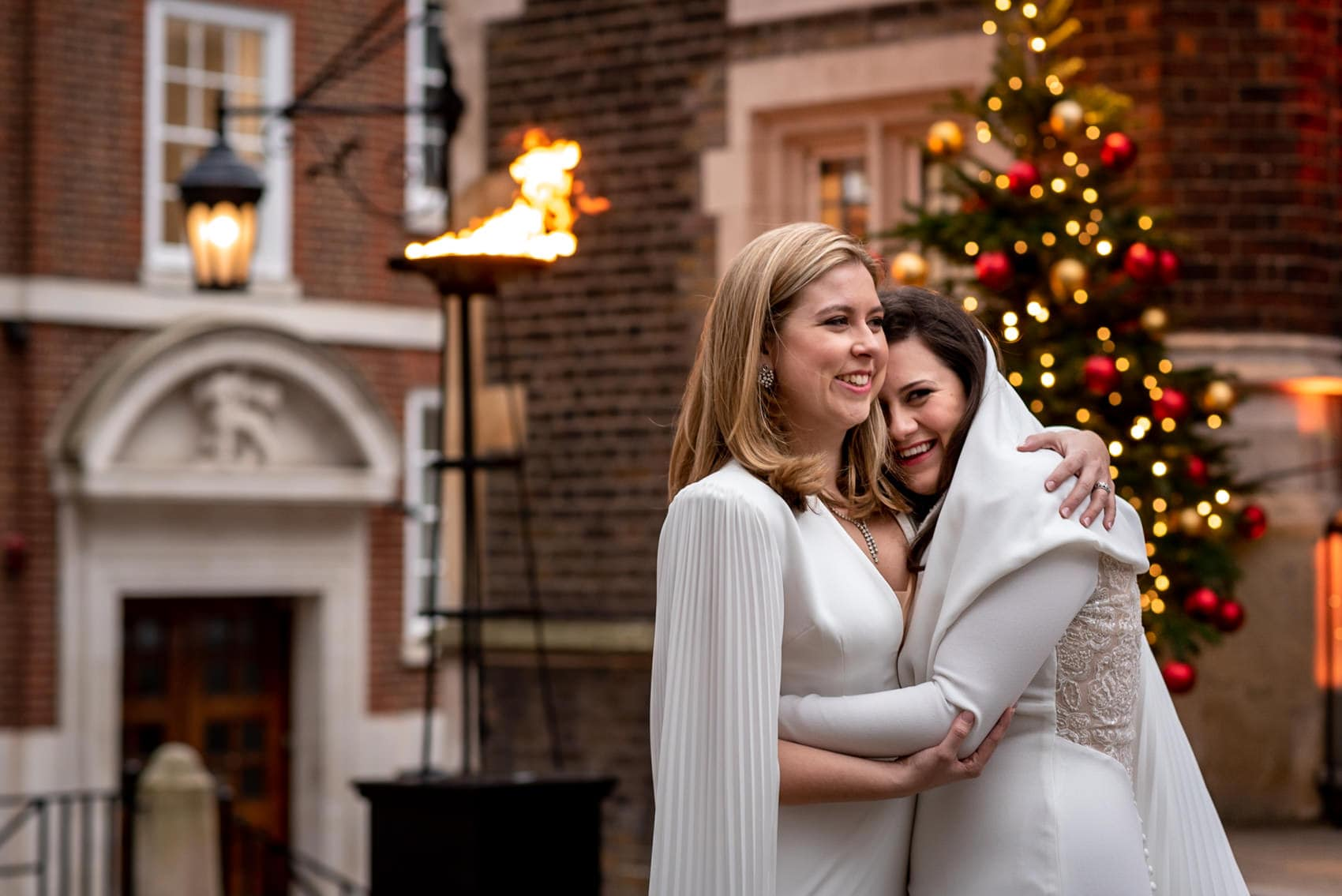 two brides hugging outside at christmas during their Middle Temple Wedding Photography
