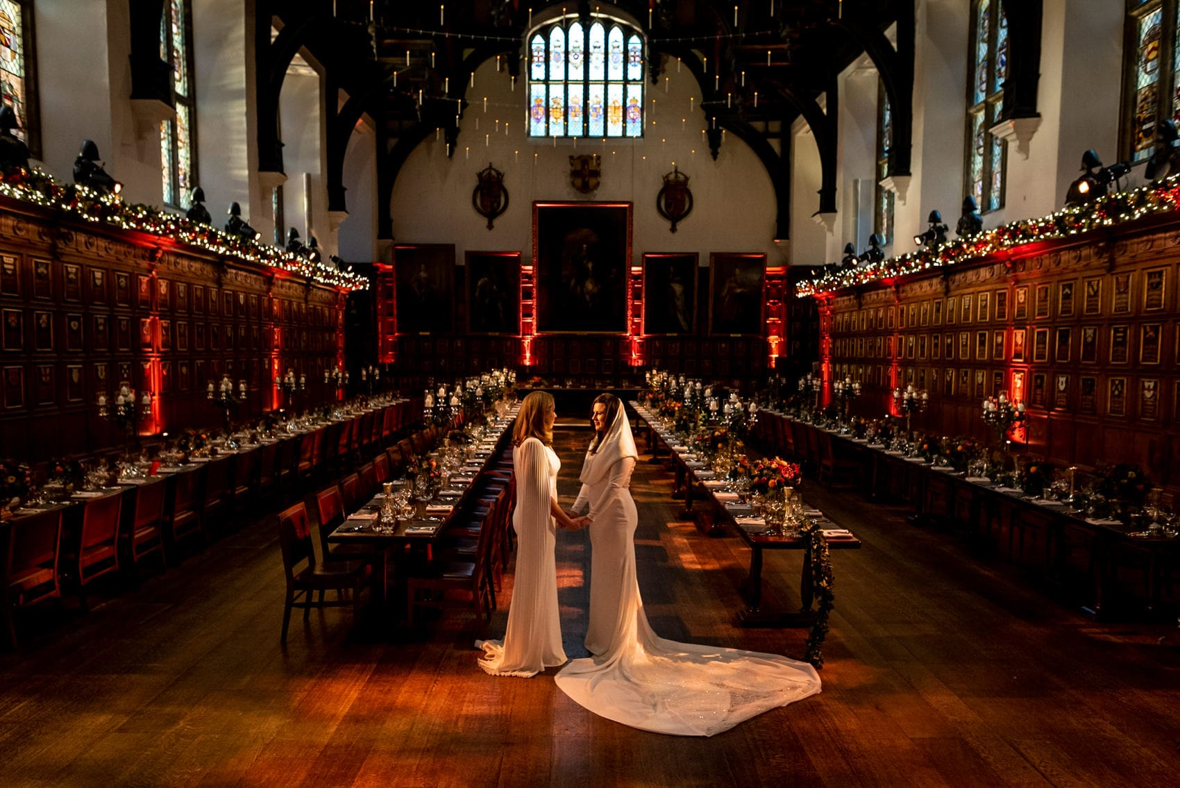 Two brides at their Middle Temple wedding in the great hall at Christmas