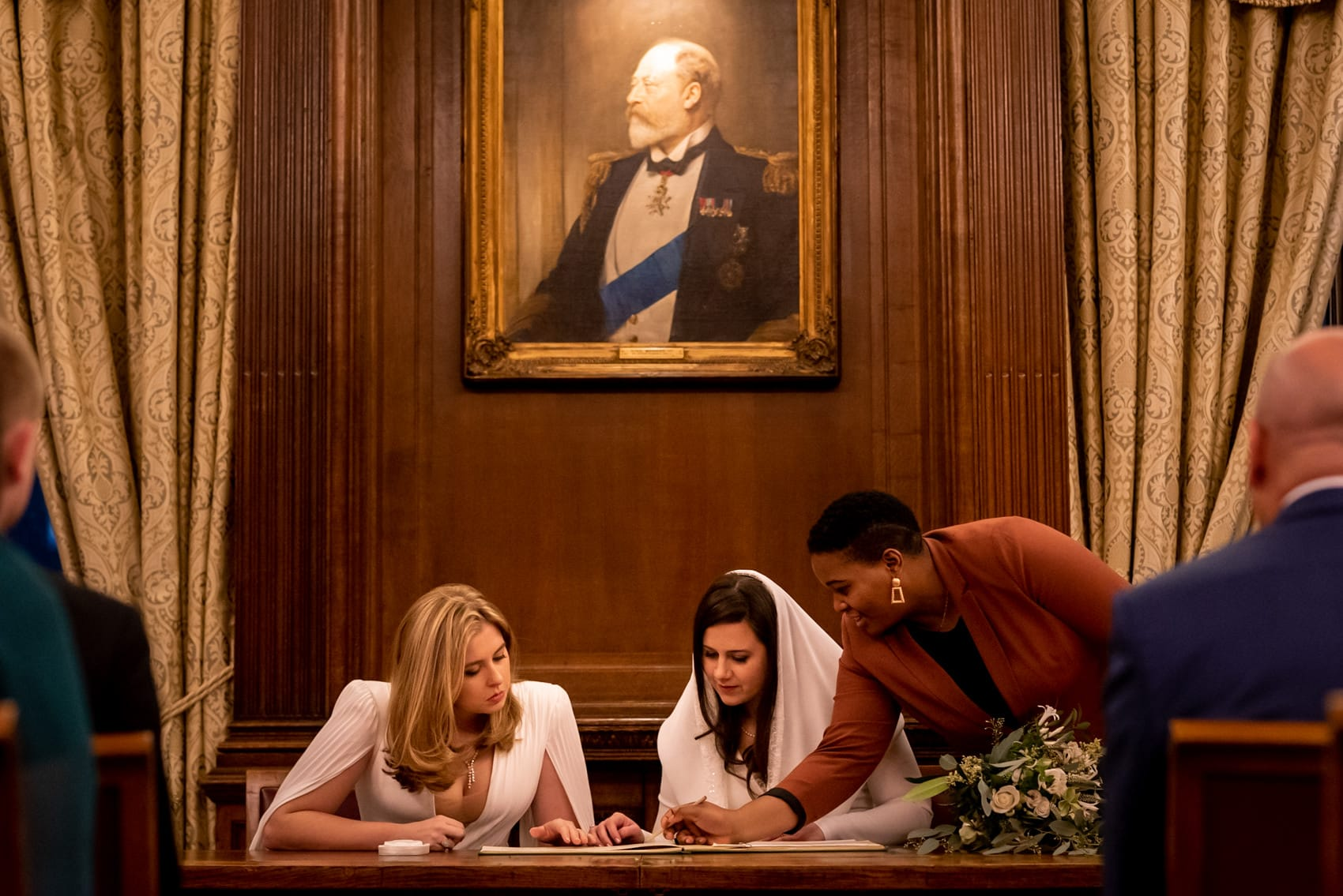 two brides signing the register at their middle temple same sex wedding
