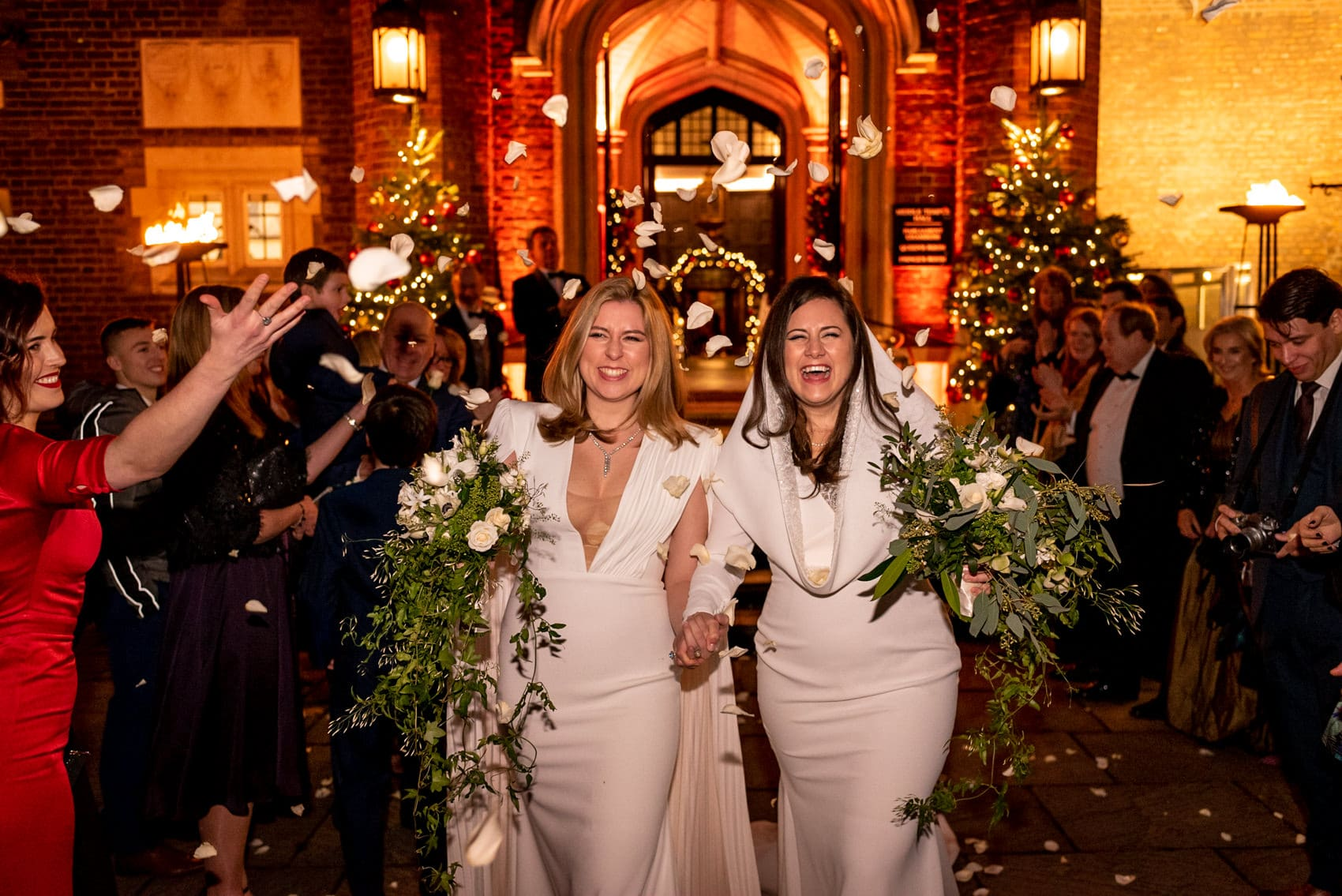 two brides confetti during their Middle Temple winter wedding photos