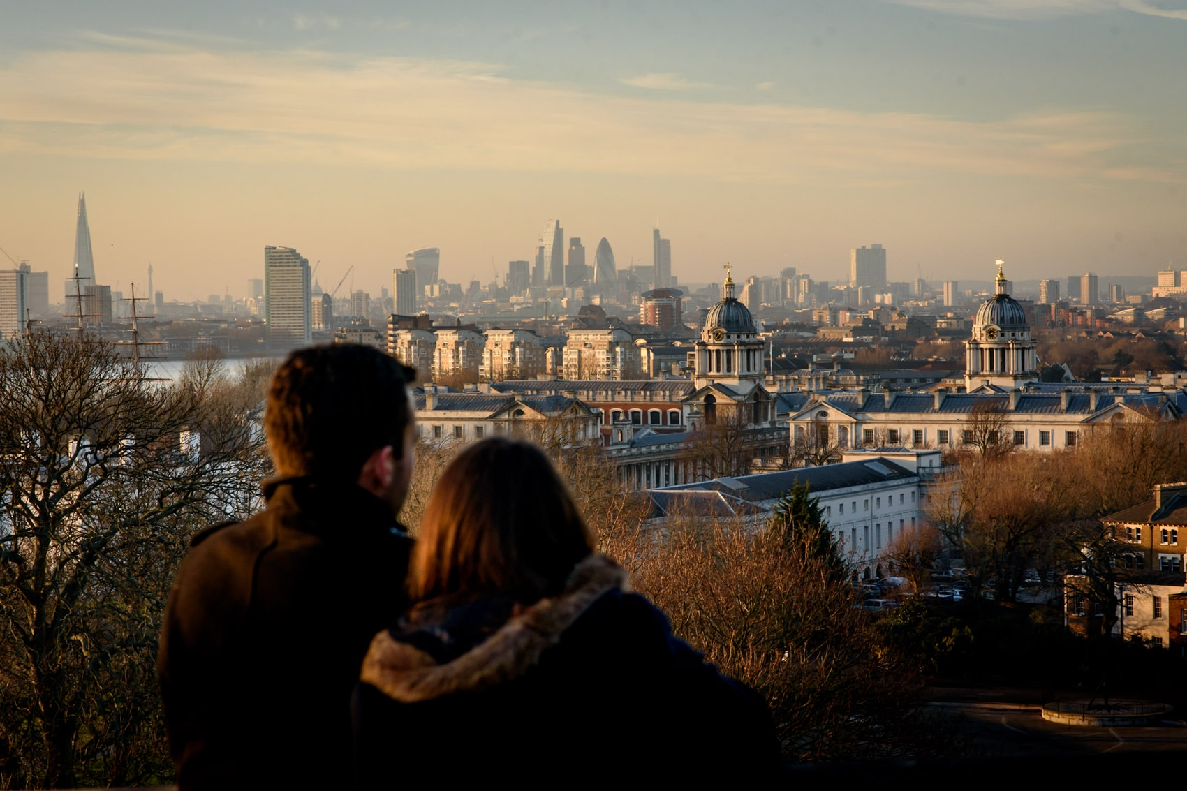 Photo of engaged couple over looking London at sunset